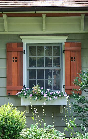Wooden exterior window shutters