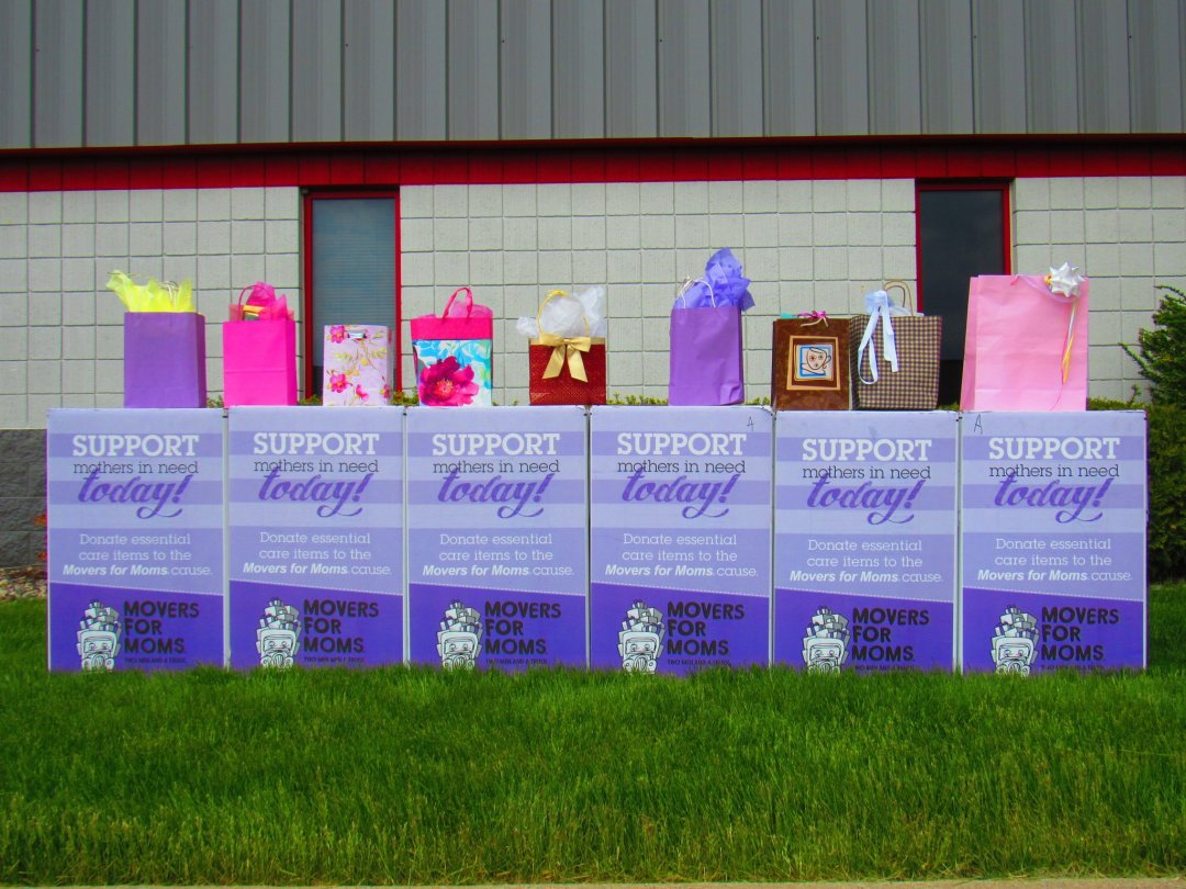 Movers For Moms boxes sitting in front of building