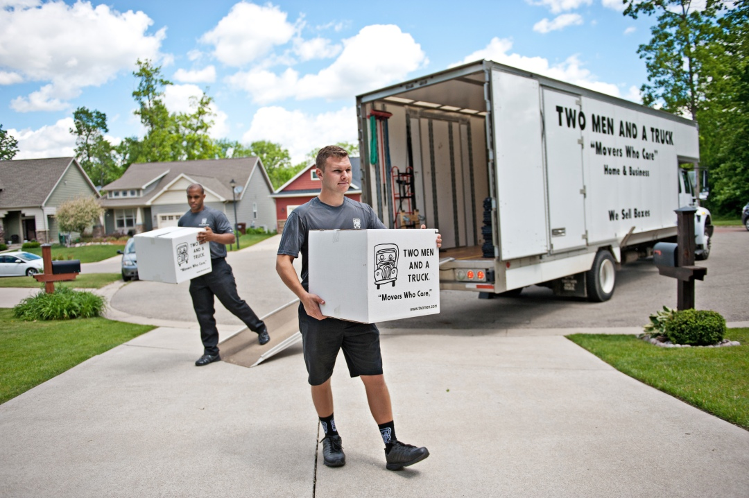 Movers carrying boxes off truck