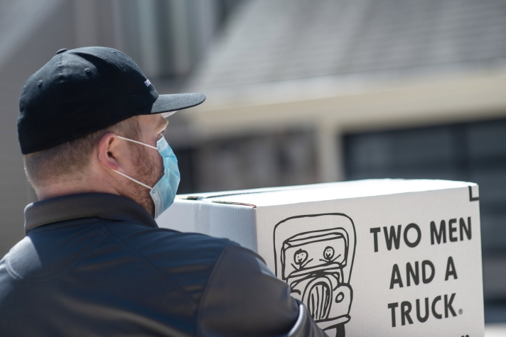 Mover with hat and mask carrying box