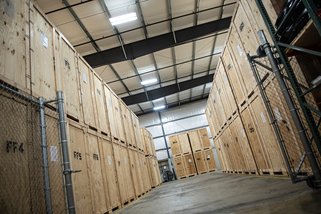 Storage crates stacked in warehouse